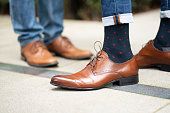 Close up of retro fashionable footwear of two young modern men
