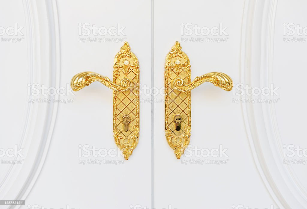 Fancy gold door handles on a house stock photo