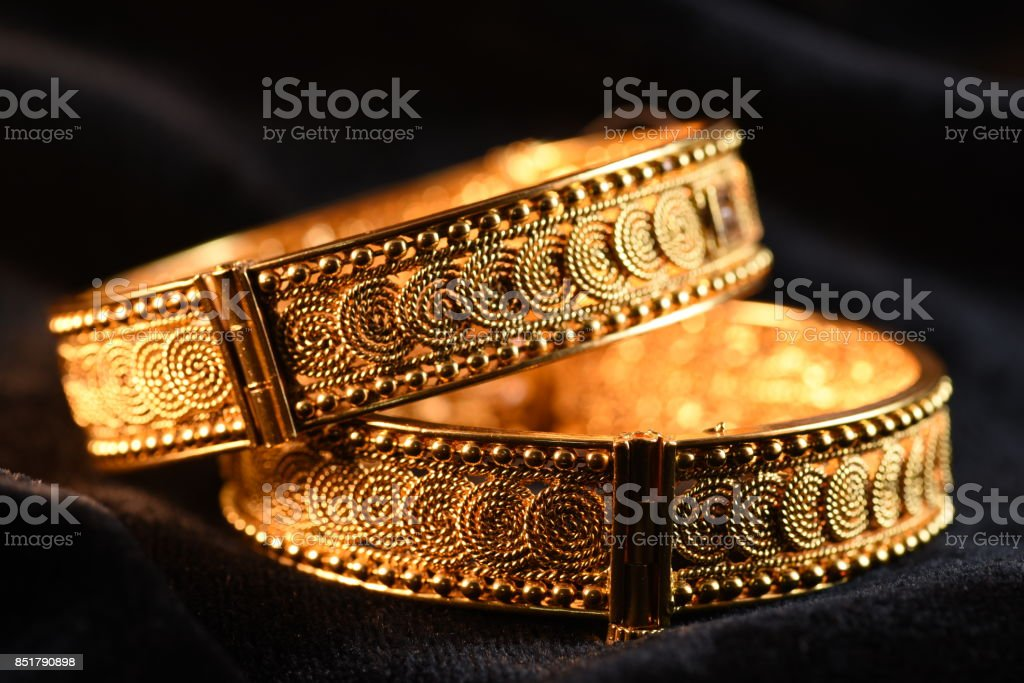 Fancy gold looking imitation bangles / bracelets for woman fashion stock photo