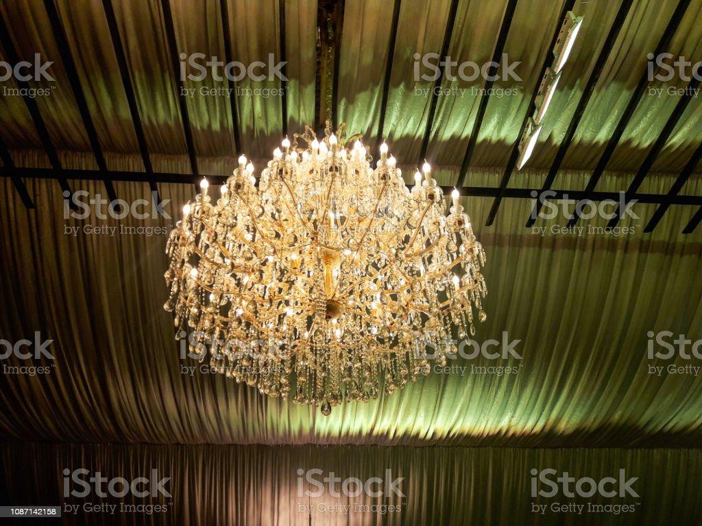 A fancy golden Chandelier stock photo