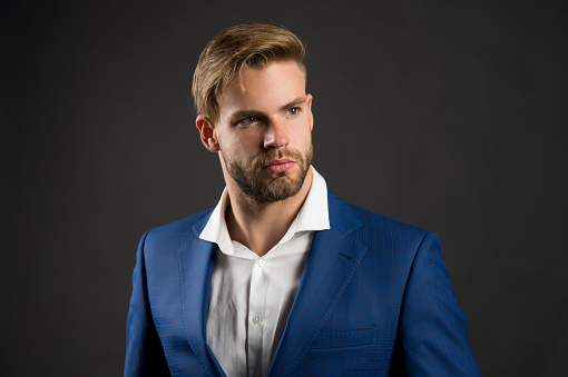 Fancy groom. Fashionable successful businessman. Businessman handsome attractive office worker. Man well groomed elegant formal suit black background. Businessman lifestyle. Good looking guy.