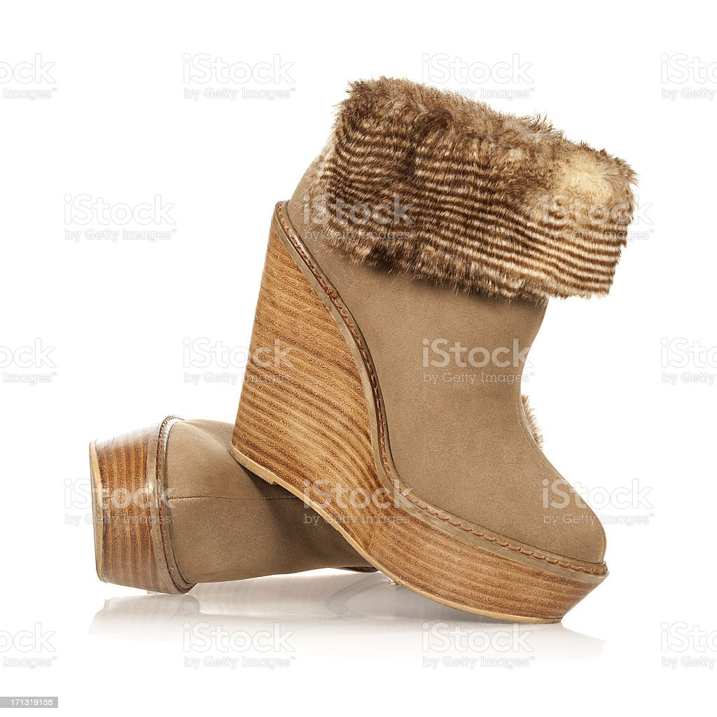 Fancy high heels ankle boots in wedge style stock photo
