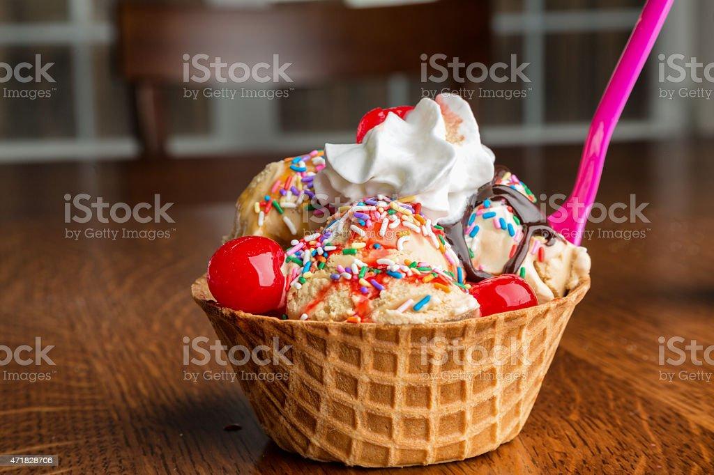Fancy Ice Cream Sundae with Hot Fudge, Sprinkles, Cherries stock photo