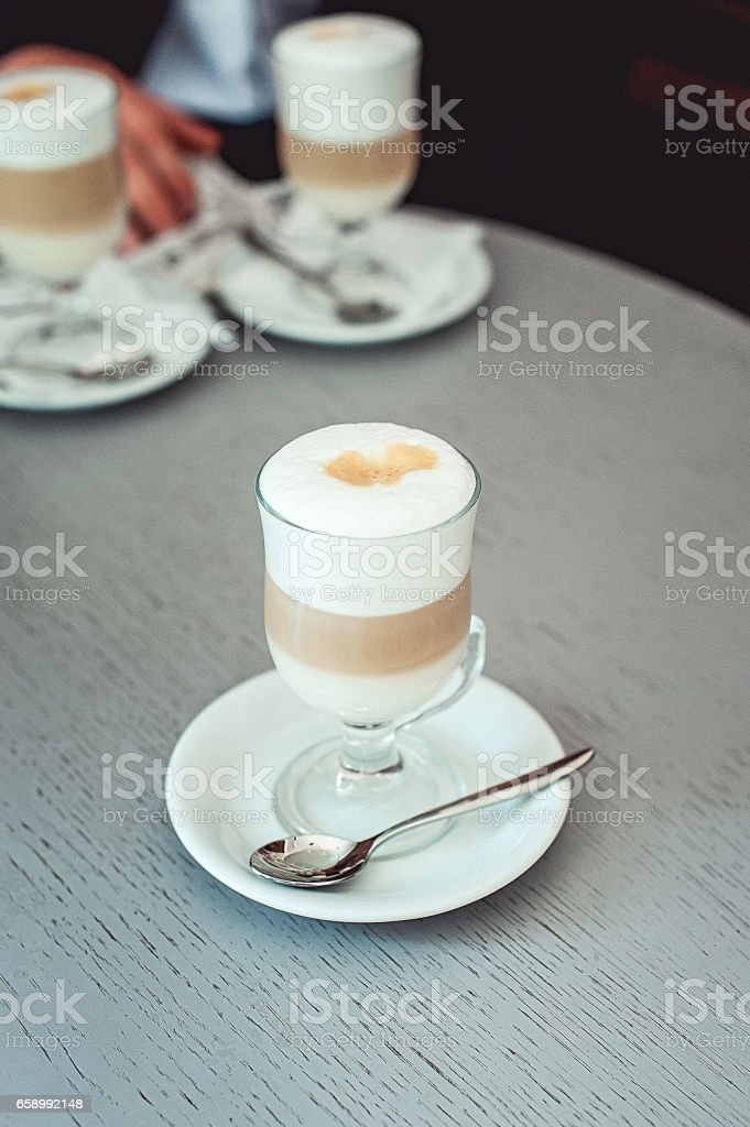 Fancy latte coffee in glass cup royalty-free stock photo
