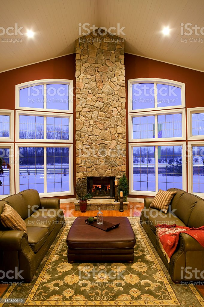 A fancy living room with stone walls and a fireplace  royalty-free stock photo