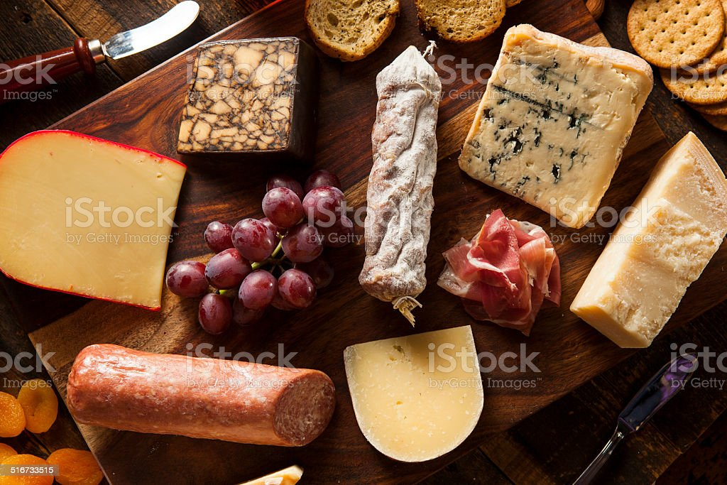 Fancy Meat and Cheeseboard with Fruit stock photo