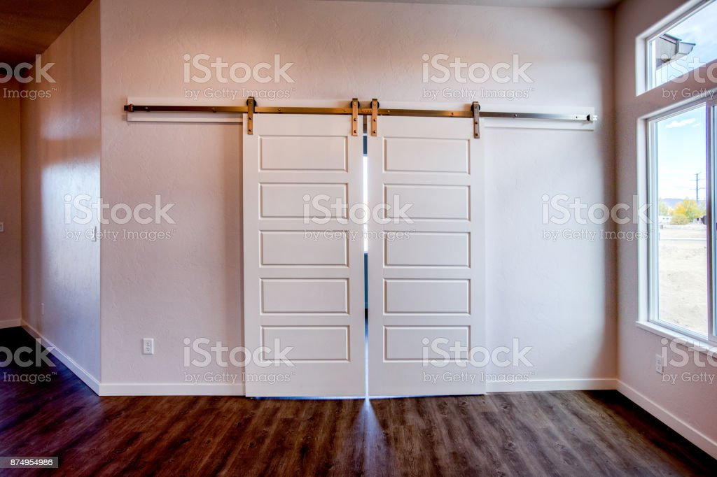 Fancy New Barn Door Entry Way in Home Interior stock photo