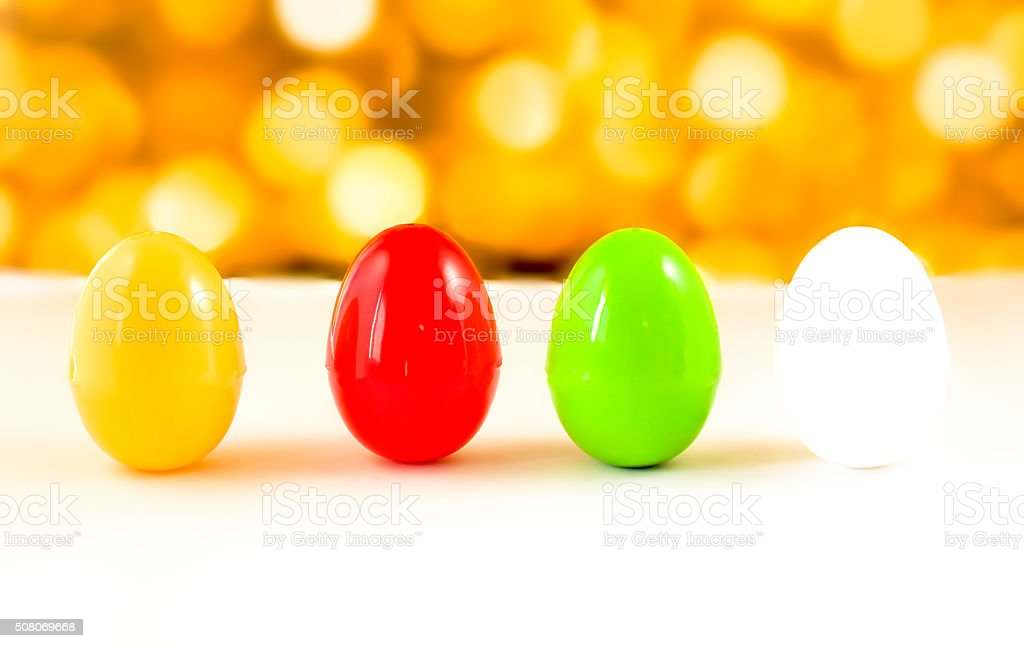 fancy or colorful of egg in yellow bokeh light background stock photo