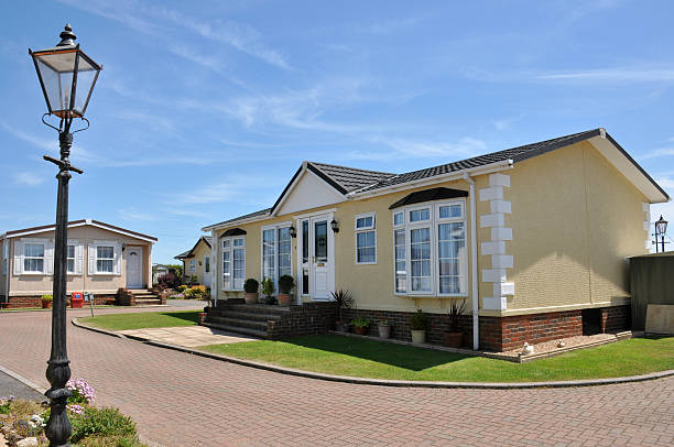 Fancy residential mobile home on beautiful property Residential mobile home park in South East England.  Generally this type of caravan park estate is for home owners over the age of fifty years. caravan photos stock pictures, royalty-free photos & images