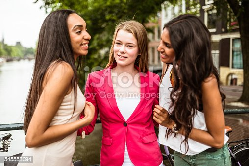 700702502istockphoto fancy teenagers have fun on the street of amsterdam 545553094