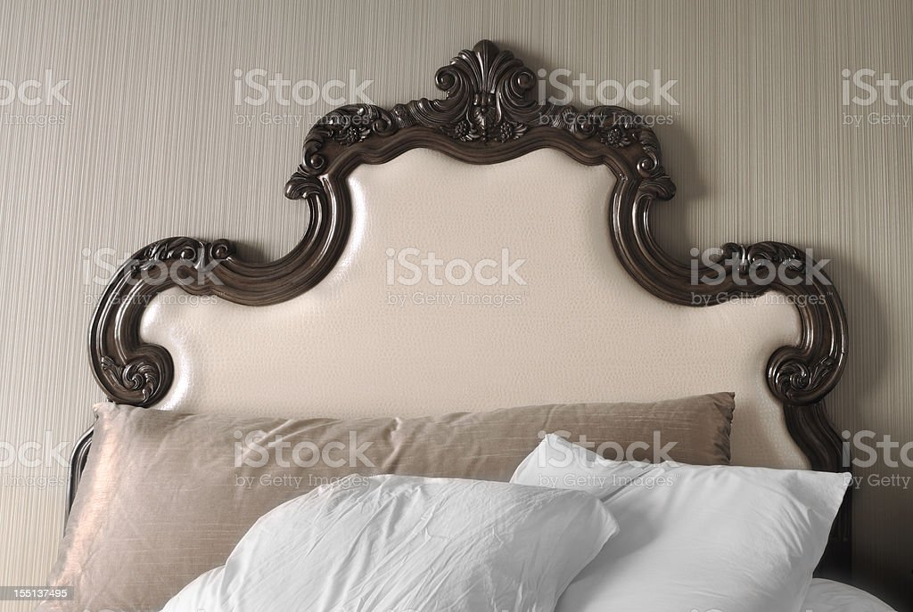 Fancy Unmade Luxury Hotel Bed Headboard and Pillows stock photo