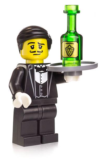 Fancy Waiter Lego Mini-figure Serving Wine stock photo