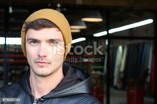 Fancy young male with beanie and piercing.