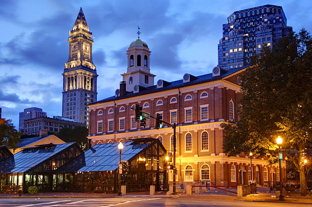 Faneuil Hall  in Boston Faneuil Hall is located near the waterfront and today's Government Center, in Boston, Massachusetts, has been a marketplace and a meeting hall since 1742.  Boston is known for its central role in American history,world-class educational institutions, cultural facilities, and champion sports franchises. market hall stock pictures, royalty-free photos & images