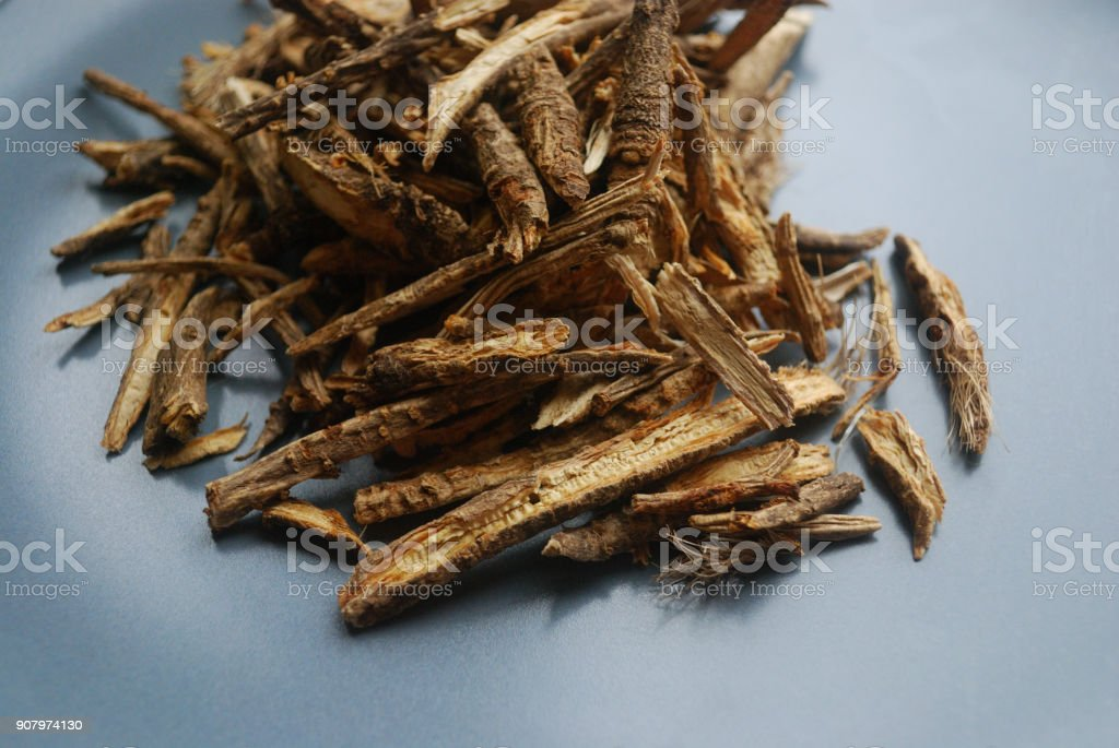 Fang feng or saposhnikovia divaricata (siler) roots close up look on neutral background. stock photo