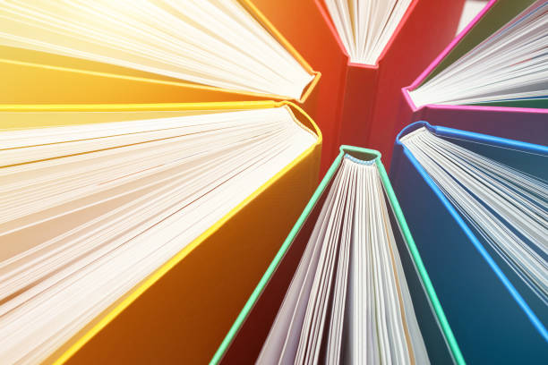 Fanned Out Colorful Books Forming Abstract Circle Pattern - Explosion of Knowledge stock photo