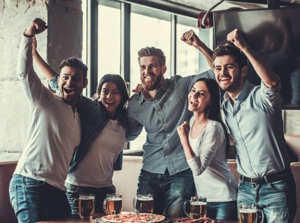 Fans at pub stock photo