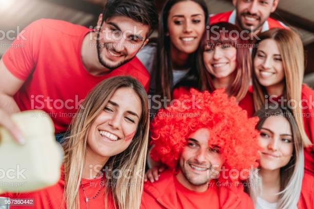Fans at stadium together taking selfie with instant print camera picture id957360442?b=1&k=6&m=957360442&s=612x612&h=oypxlwrl9hp0rnejb1byzyvvvldtyf4dizf20q6s8eg=
