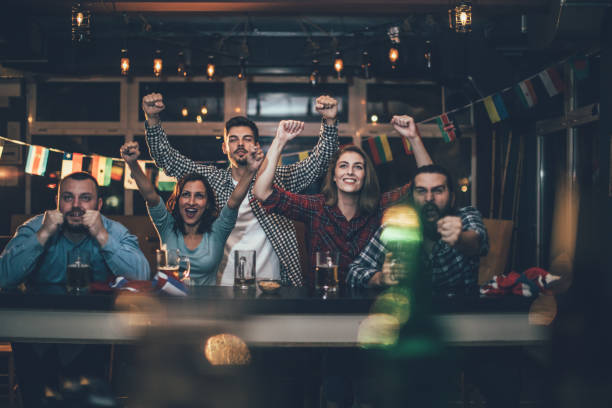 Fans at the bar celebrating stock photo