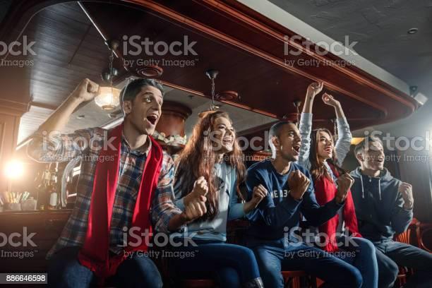 Fans at the bar joyfully screaming and celebrate victory of their picture id886646598?b=1&k=6&m=886646598&s=612x612&h=cwo1k82xpzvhkudl2djhpkkwefmuffkyk 1uyy0el4o=