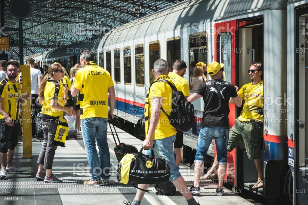 BVB Fans / Borussia Dortmund Fans arriving on train station stock photo