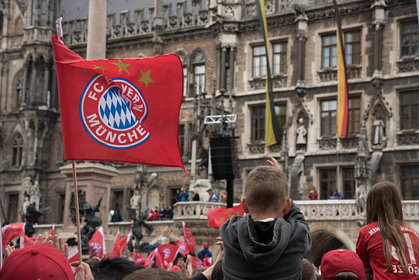 Fans celebrating for FC Bayern Munich for winning the Bundesliga title Munich, Germany - May 24 2015: Fans celebrating for FC Bayern Munich for winning the Bundesliga title at Marienplatz, Munich fan club stock pictures, royalty-free photos & images