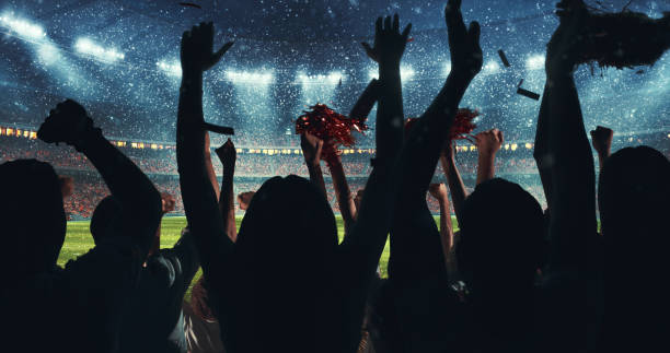 Fans celebrating the success of their favorite sports team on the stands of the professional stadium while it's snowing Fans celebrating the success of their favorite sports team on the stands of the professional stadium while it's snowing. Stadium is made in 3D. spectator stock pictures, royalty-free photos & images
