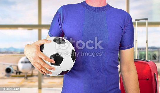 istock fans chasing their team 864452442