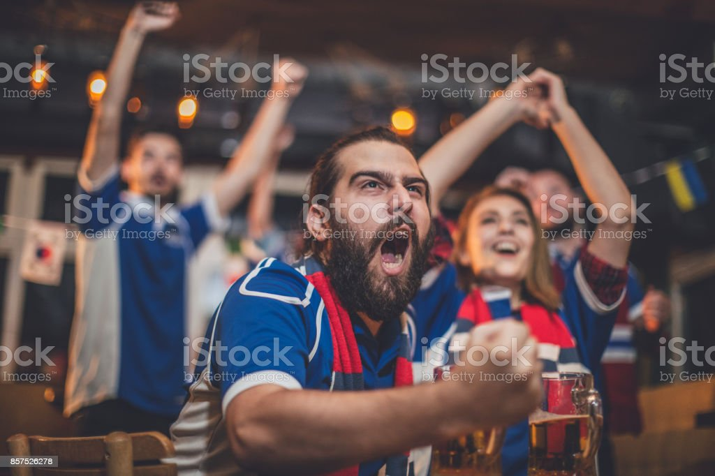 Fans cheering for their team stock photo