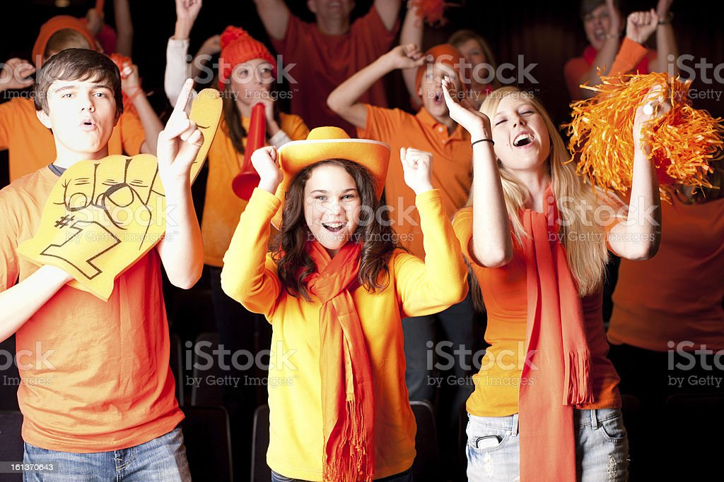 Fans: Children Teenagers Cheering Fans Sports Event Team Color Orange royalty-free stock photo