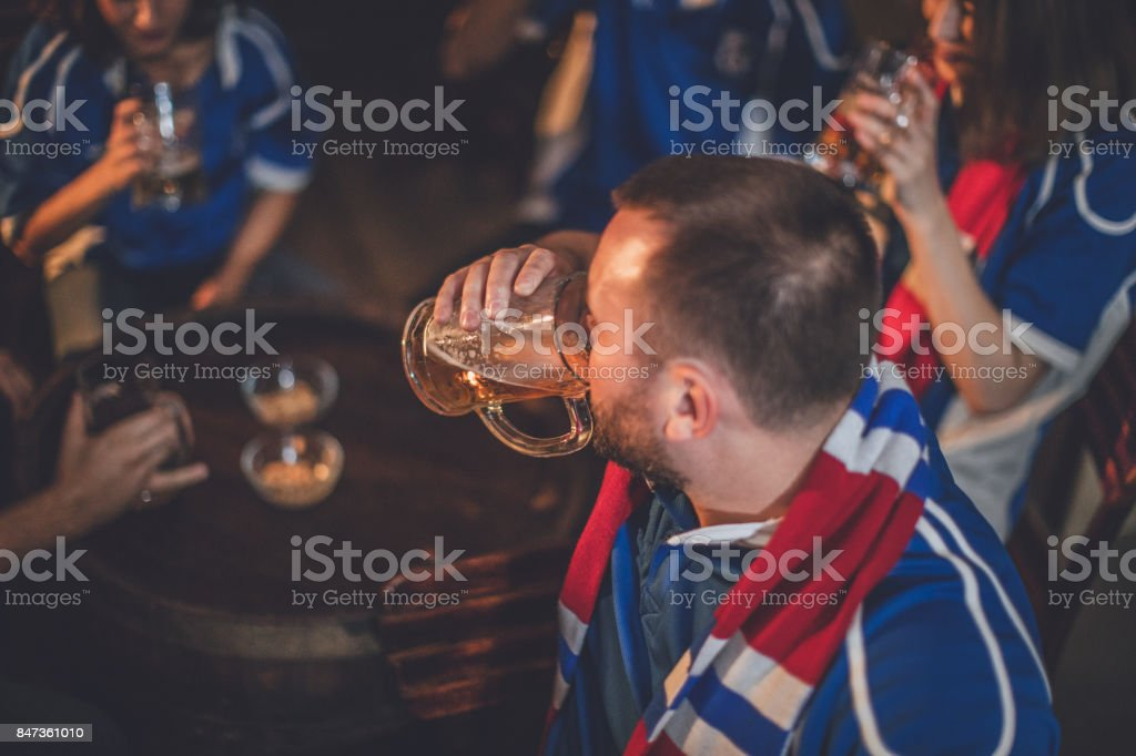 Fans drinking beer stock photo