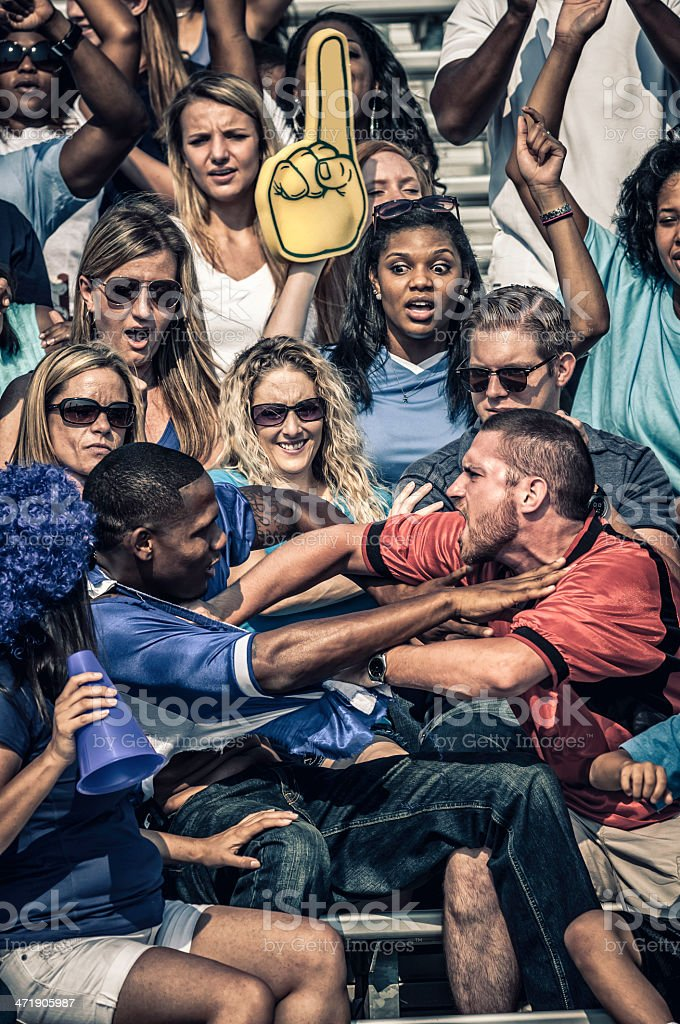 Fans fighting at the American Football match royalty-free stock photo