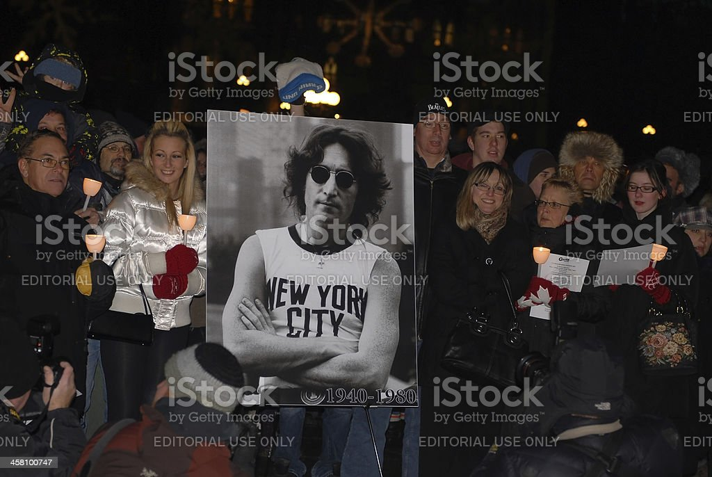 Fans gather to honor John Lennon stock photo