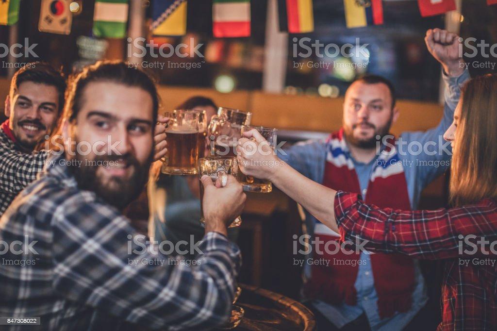 Fans having a toast stock photo