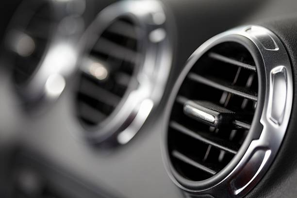 fans in a modern sports car fans in a modern sports car dashboard vehicle part stock pictures, royalty-free photos & images