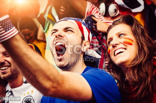 537894724 istock photo Fans of different nations at the stadium together 466013139