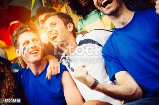 537894724 istock photo Fans of different nations at the stadium together 467903849