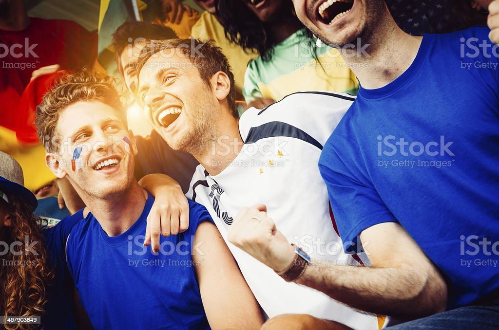 Fans of different nations at the stadium together stock photo