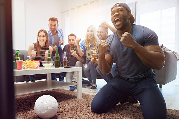 Fans of soccer in the living room stock photo