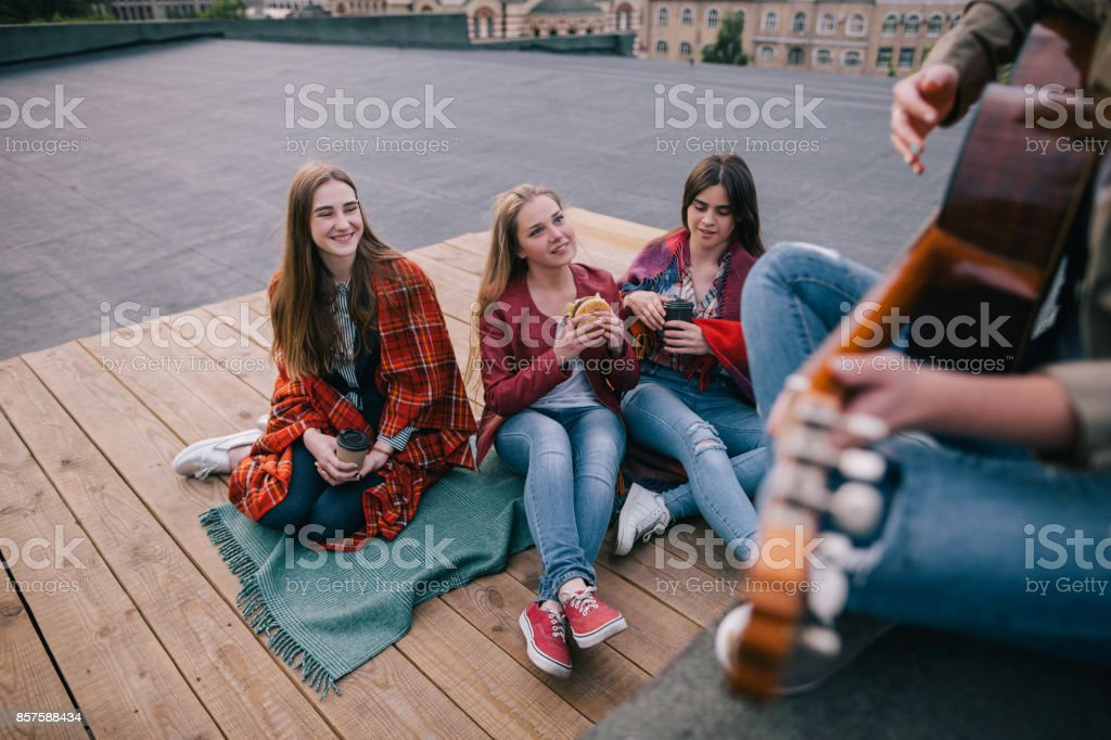 Fans on live music show. Friends leisure stock photo