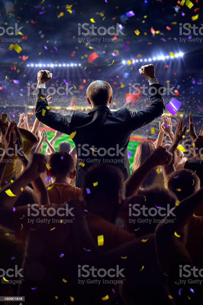 Fans on stadium game businessman Fans on stadium soccer game Confetti and tinsel Adult Stock Photo