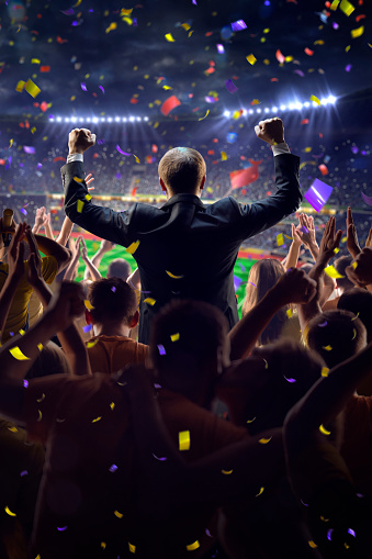 Fans On Stadium Game Businessman Stock Photo - Download Image Now