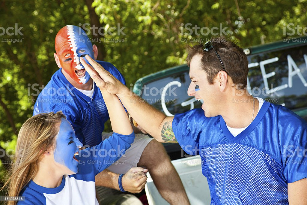 Fans on Truck Tailgate Giving High Fives royalty-free stock photo