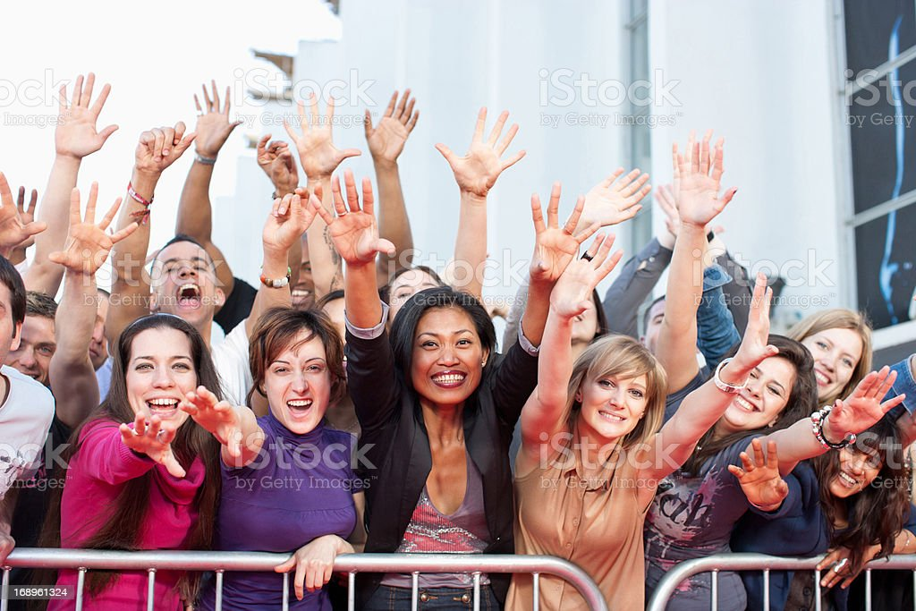Fans reaching out over barrier royalty-free stock photo