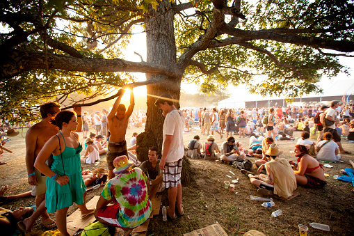 Fans Relaxing At Sunset During Bonnaroo Music And Arts Festival Stock Photo - Download Image Now