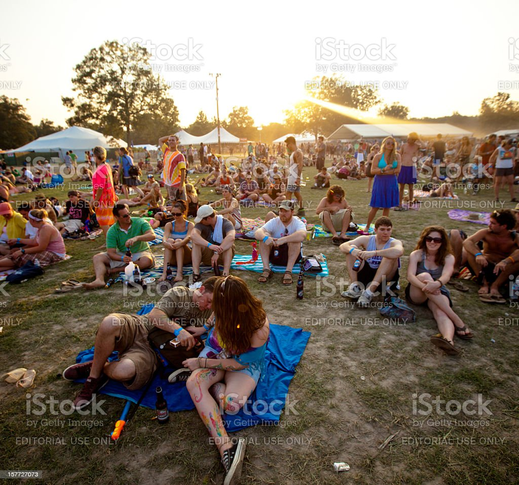 Fans relaxing at sunset during Bonnaroo Music and Arts Festival royalty-free stock photo