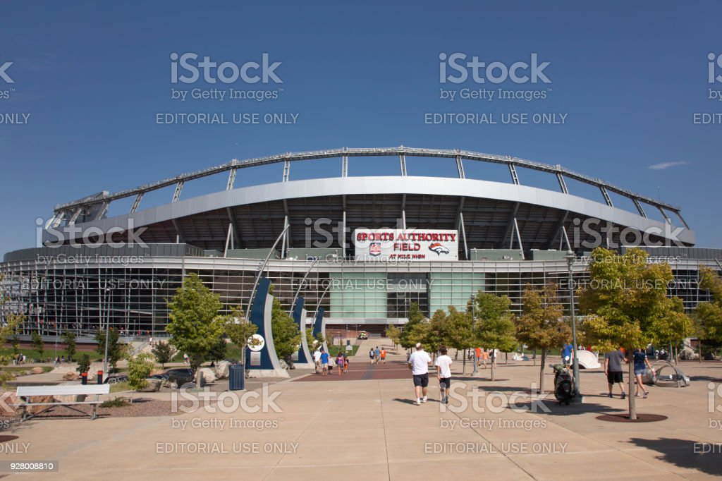 Fans visitors walk Sports Authority Field at Mile High Denver Colorado summer stock photo