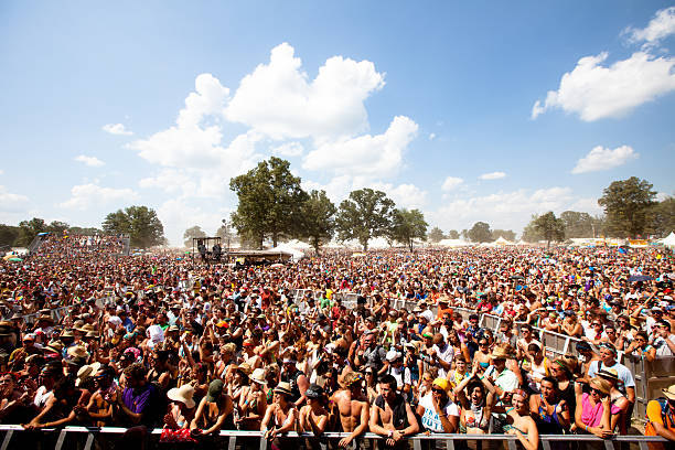 Fans waiting for the next performance at Bonnaroo Music Festival stock photo