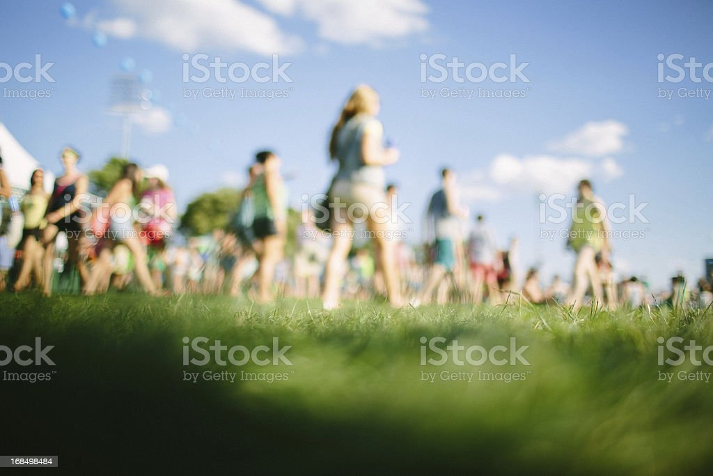Fans walking at music festival stock photo