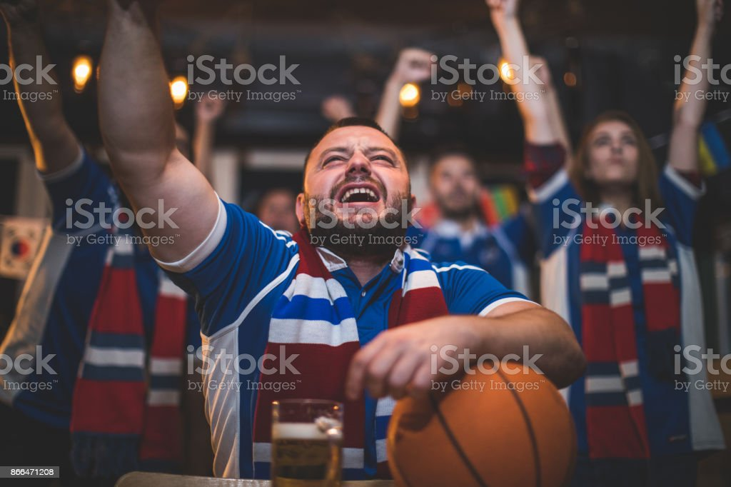 Fans watching basketball game stock photo